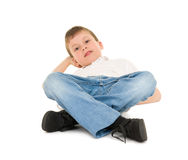 Boy lay on your back on white Royalty Free Stock Photography