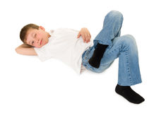 Boy lay on your back on white royalty free stock photo