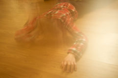 Boy laying on the floor Stock Images