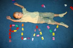 Boy laying on floor Stock Images