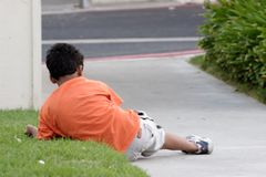 Boy laying on the grass Stock Image