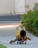 Boy laying on his skateboard Royalty Free Stock Photography