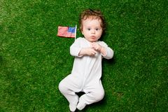 Free Boy Laying On Grass With USA Flag Royalty Free Stock Image - 113593776