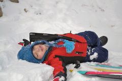 Boy laying in the snow Royalty Free Stock Photo
