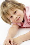 Boy Laying on Stomach Royalty Free Stock Image