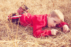 Boy lays relaxing in pasture Royalty Free Stock Photo