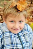 Boy with leaf on head Royalty Free Stock Photography