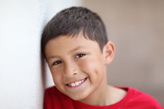 Boy leaning against wall Stock Image