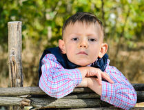 Boy Leaning on Arms on Top of Wooden Fence Royalty Free Stock Photography