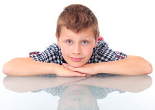 Boy leaning on school desk Royalty Free Stock Photography