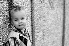 Boy leaning at a wall Stock Photo