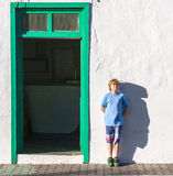 Boy leaning at a wall and throwing a funny shadow Royalty Free Stock Image