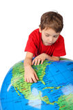 Boy leans on inflatable globe isolated on white Stock Images