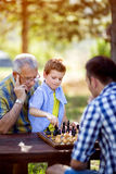 Boy learn chess on a table Royalty Free Stock Photography