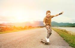 Boy learn to skate on skateboard royalty free stock photo