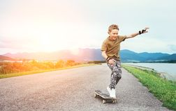 Boy learn to skate on skateboard royalty free stock images