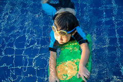 Boy learn to swim in the swimming pool Royalty Free Stock Photography