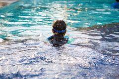 Boy learn to swim in the swimming pool Stock Images