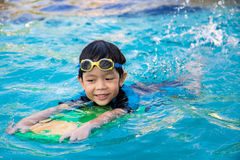 Boy learn to swim in the swimming pool.  royalty free stock photos