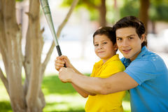 Boy learning baseball with his dad Royalty Free Stock Photo