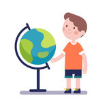 Boy learning geography with earth globe Royalty Free Stock Photo