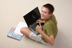 Boy learning at home with notebook Stock Photography