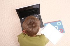 Boy learning at home with notebook Royalty Free Stock Photos