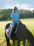 Boy Learning Horseback Riding Royalty Free Stock Photo