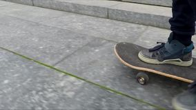 Boy learning hot to skate stock video footage