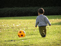 Boy learning soccer Stock Image