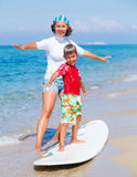 Boy learning surfing Stock Images