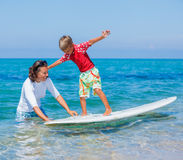 Boy learning surfing Royalty Free Stock Photography