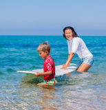 Boy learning surfing Stock Photo