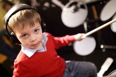 Boy learning to play drums royalty free stock image