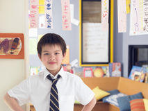 Boy Learning To Read From Hanging Paper Strip In Class. Elementary schoolboy learning to read from hanging paper strip in classroom Stock Image