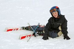 Boy learning to ski. Portrait of young boy in the snow Royalty Free Stock Photos