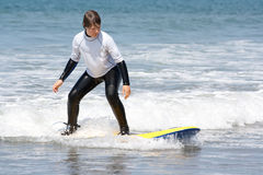 Boy learning to surf 2 Stock Images