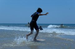 Free Boy Learning To Surf On Beach Stock Images - 610754