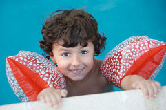 Boy learning to swim royalty free stock photo