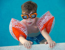Boy learning to swim royalty free stock image