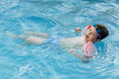 Boy learning to swim stock images