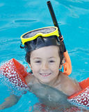 Boy learning to swim royalty free stock images