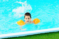 Boy learning to swim. In a pool Royalty Free Stock Images