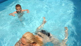 Boy Learning To Swim In The Pool 02 stock footage