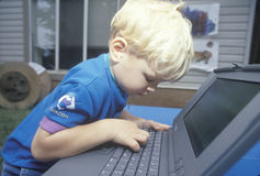 A boy learning to use a laptop computer in Washington, D.C. Stock Photography