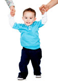 Boy learning to walk Royalty Free Stock Photos