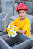 Boy learning the tricks of trade. Vocational guidance concept - boy learning the tricks of trade at a construction site royalty free stock images