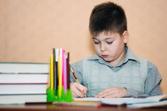 Boy learns at home Stock Photo