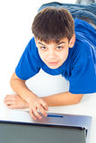 Boy learns a laptop Royalty Free Stock Image