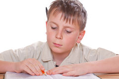 Boy learns lessons Royalty Free Stock Photo